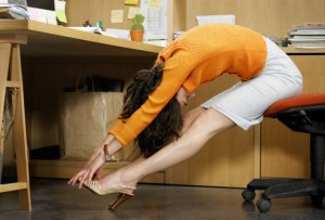 getty_rm_photo_of_woman_stretching_at_desk