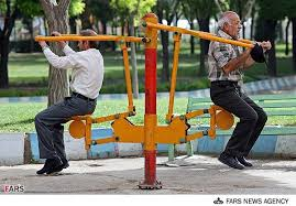 old men working out in park